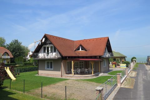 The Beach House is located in the village of Balatonlelle, on a dead-end street near Lake Balaton. In this quiet environment you can relax, enjoy the sunshine and take a refreshing dip in the Balaton, which is just 30m away. In the garden there is a ...