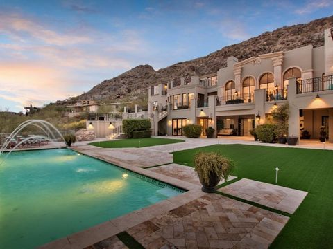 Perched high on the south side of Mummy Mountain lies one of Paradise Valley's most luxurious residences. Offering the most unique indoor/outdoor living experience that is truly unrivaled. Newly enhanced game room, theater room and additional bedroom...