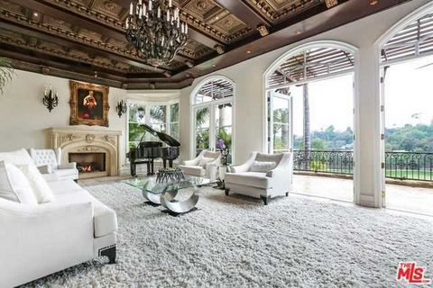Detailed Description: Mediterranean-style home with magnificent unobstructed views overlooking the Bel Air Golf Course and private grounds with over 31,000 sq.ft of tropical paradise beauty, three waterfalls, gardens, pool, and an outdoor tea, medita...