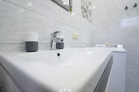 2-level apartments with 2 rooms are located at 9 Zhovkivska Street, on the 1/2 floor. The apartments have: - Built-in kitchen; - Refrigerator; - Microwave; - Electric kettle; - Gas stove; - Cutlery; - Kitchen appliances; - Wine glasses; - Water glass...