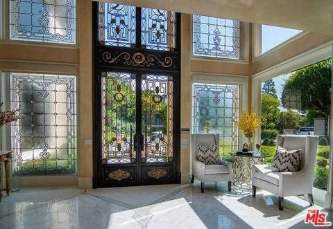etailed Description: Extraordinary 10,000 + sq. Ft. Italian Villa with tennis court and beautiful canyon / city views is situated on a 26,000 + sq. Ft. Lot at the end of a private cul-de-sac in the prestigious guard-gated community of Bel Air Crest. ...